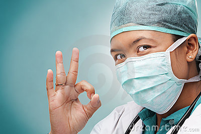 Female medical doctor with ok sign