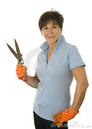 Female middle age woman gardener grass clippers