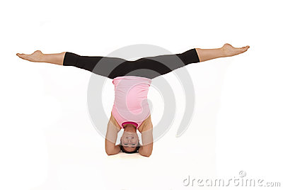 Female model doing yoga open angle pose in headsta