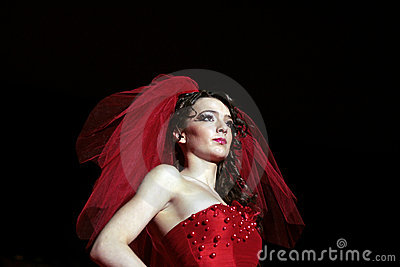Female model on fashion show in evening dress Editorial Image