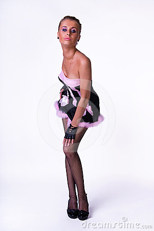 Female model posing in black and pink dress