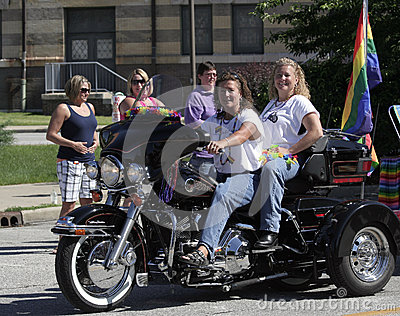 Female Motorcycle Riders with Rainbow Flag at Indy Pride Parade Editorial Image