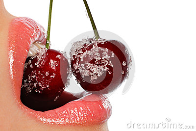Female mouth with red cherries