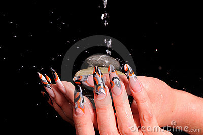 Female nails and falling drops of water