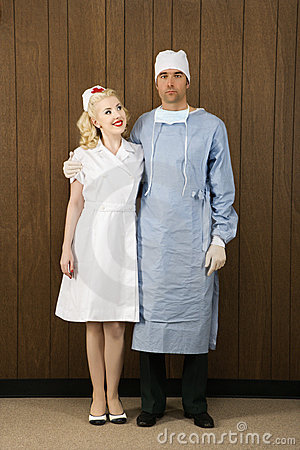 Female nurse and male surgeon standing together.