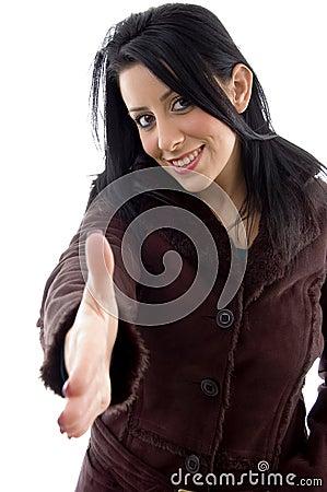 Female offering handshake on white background
