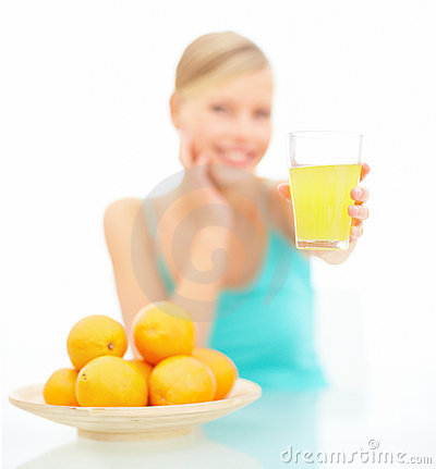 Female offering orange juice over white backgro