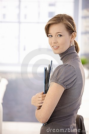Female office worker with folders