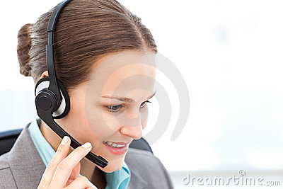 Female operator on the phone with earpiece