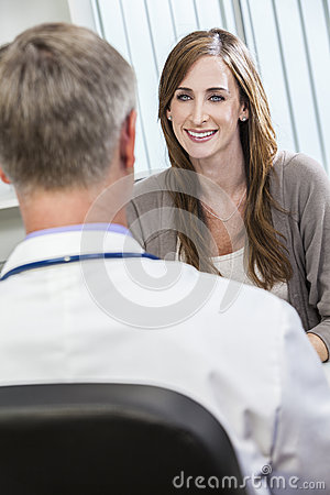 Female Patient and Male Doctor in an Office