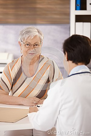 Free Female Pensioner At Doctors Office Royalty Free Stock Image - 27720746