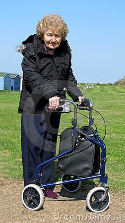 Female pensioner with delta walking aid