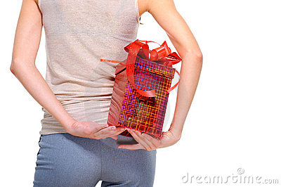 Female person hide behind back the big present box