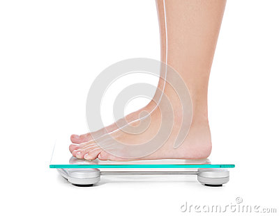 Female person standing on weight scale