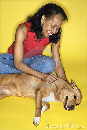 Female petting dog.