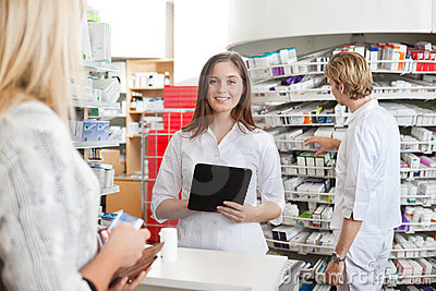 Female Pharmacist Holding Tablet PC