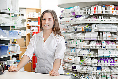 Female Pharmacist Standing at Counter