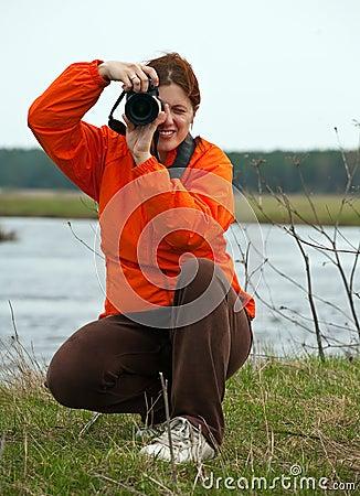 Female photographer against  nature