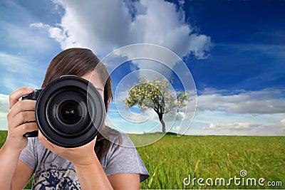 Female photographer with digital photo camera