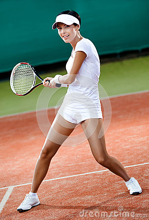 Female player at the clay tennis court
