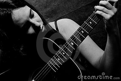 Female Playing Guitar
