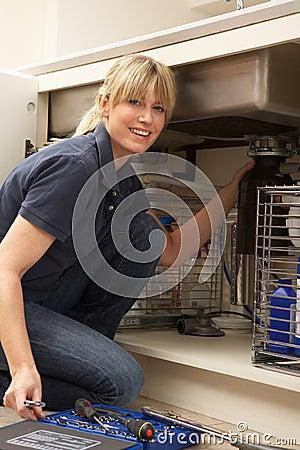 Female Plumber Working On Sink