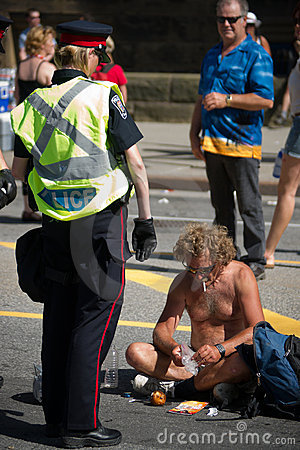 Female Police Officer Confronting Shirtless Man Editorial Image