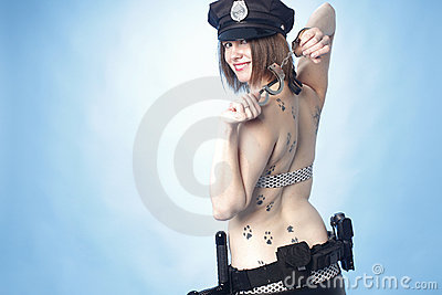 Female police officer with cuffs