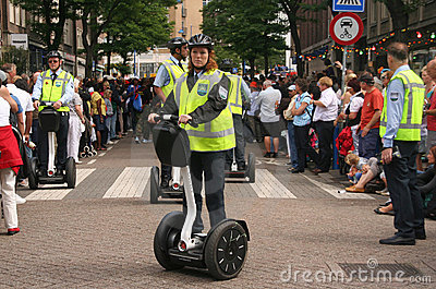 Female police officer on Segway Editorial Photography