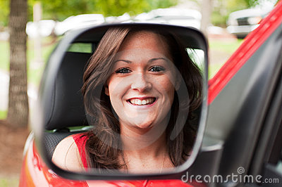 Female Portrait in Vehicle Mirror