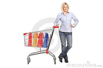 Female posing next to a shopping cart