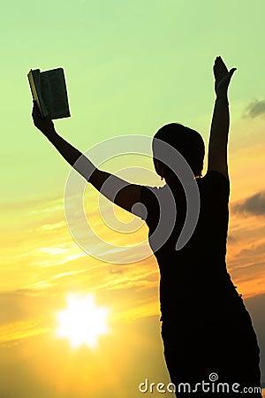 Female praying with bible #3