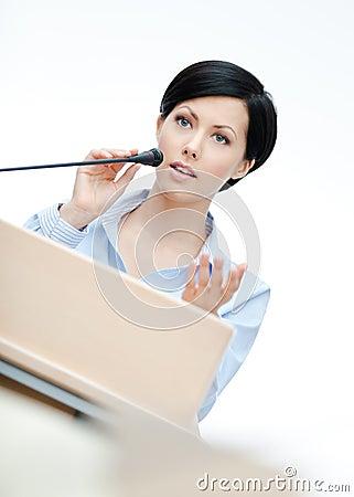 Female presenter at the podium