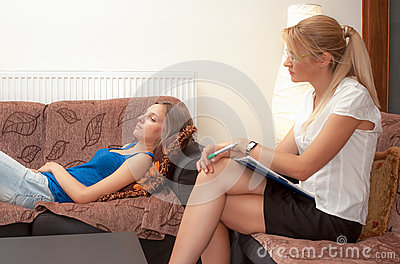 A female psychotherapist treats a female patient