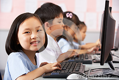 Female Pupil Using Keyboard During Computer Class