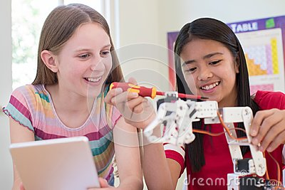 Two Female Pupils In Science Lesson Studying Robotics Stock Photo