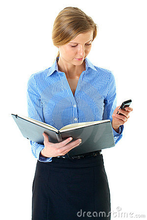 Female read notes in her diary and check mobile