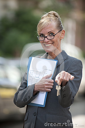 Female Real Estate Agent holding house key