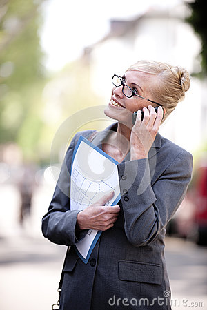 Female Real Estate Agent talking on phone
