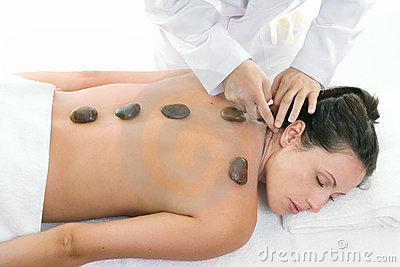 Female receiving a relaxing massage treatment