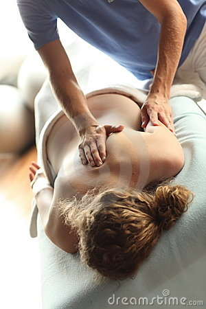 Female receiving shiatsu massage