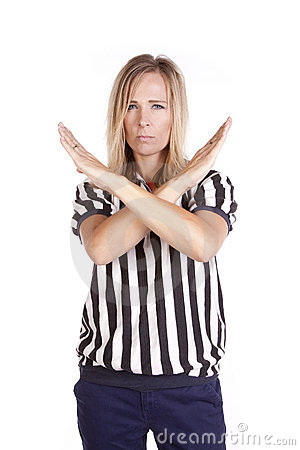 Female referee arms crossed