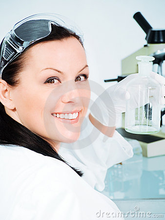 Female researcher holding glass tube