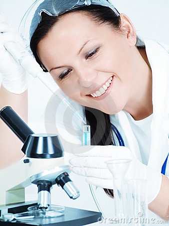 Female researcher holding test tu