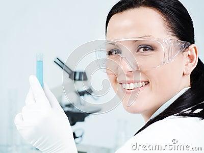 Female researcher holding test tube