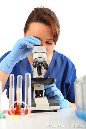 Female Researcher looking into a microscope