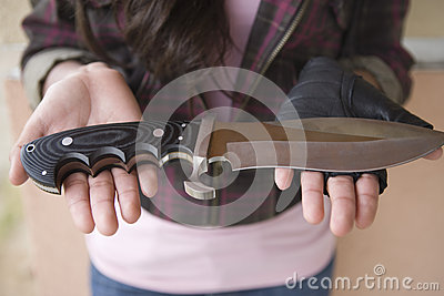 Female Robber With Knife On Her Palms