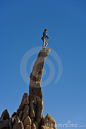 Female rock climber on the summit.