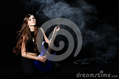 Female rock star playing the guitar Stock Photo