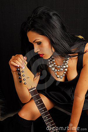 female rocker with guitar
